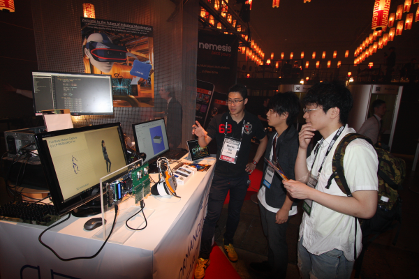 Our booth at Slush Asia was pretty popular. CTO Yap is explaining to visitors.